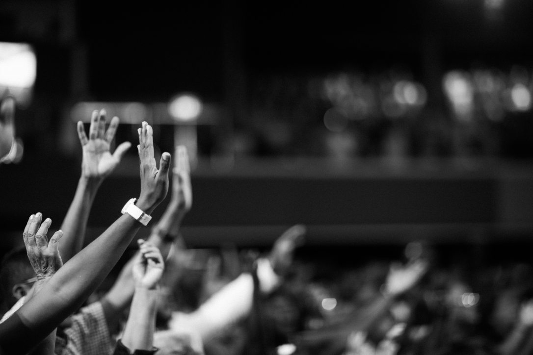 grayscale-photography-of-hands-waving-2014773